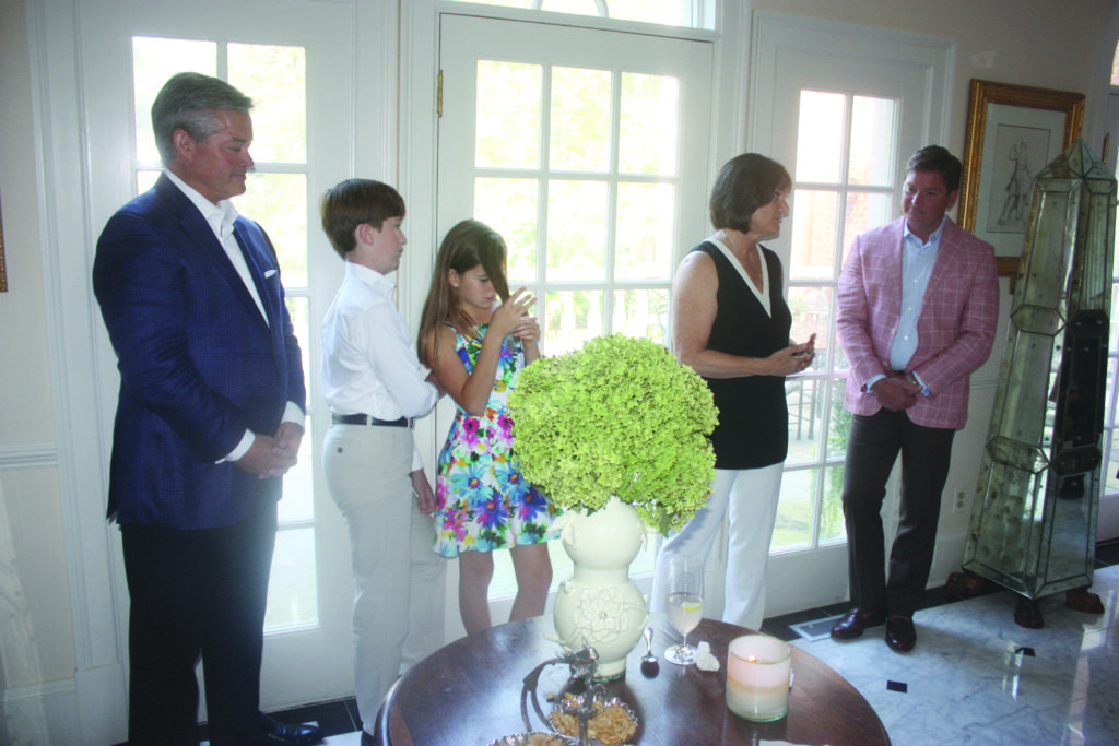 AT THE HOME OF MARK LOWHAM (left), Joe Russo (right) and their children, Alexander and Elizabeth, U.S. Democratic congressional candidate LuAnn Bennett (center) discussed her chances of upending incumbent Republican Barbara Comstock in the 10th District adjacent Falls Church this fall. Bennett's special guest at the event were retired U.S. Reps. Barney Frank and Jim Moran. (Photo: News-Press)