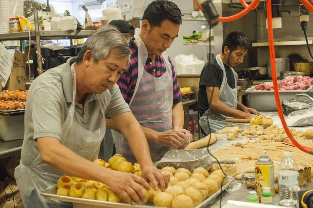 CHA KIM PHUNG BAKERY owner Vinh Tran and Phong Ly prepare mooncakes in the kitchen of Tran's bakery. (Photo: Drew Costley/News-Press)