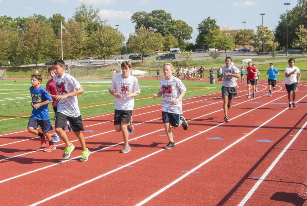 MASON'S CROSS-COUNTRY team warms up at a recent practice. The team's first invitational is Saturday, Sept. 10 against Handley. (Photo: Drew Costley/News-Press)