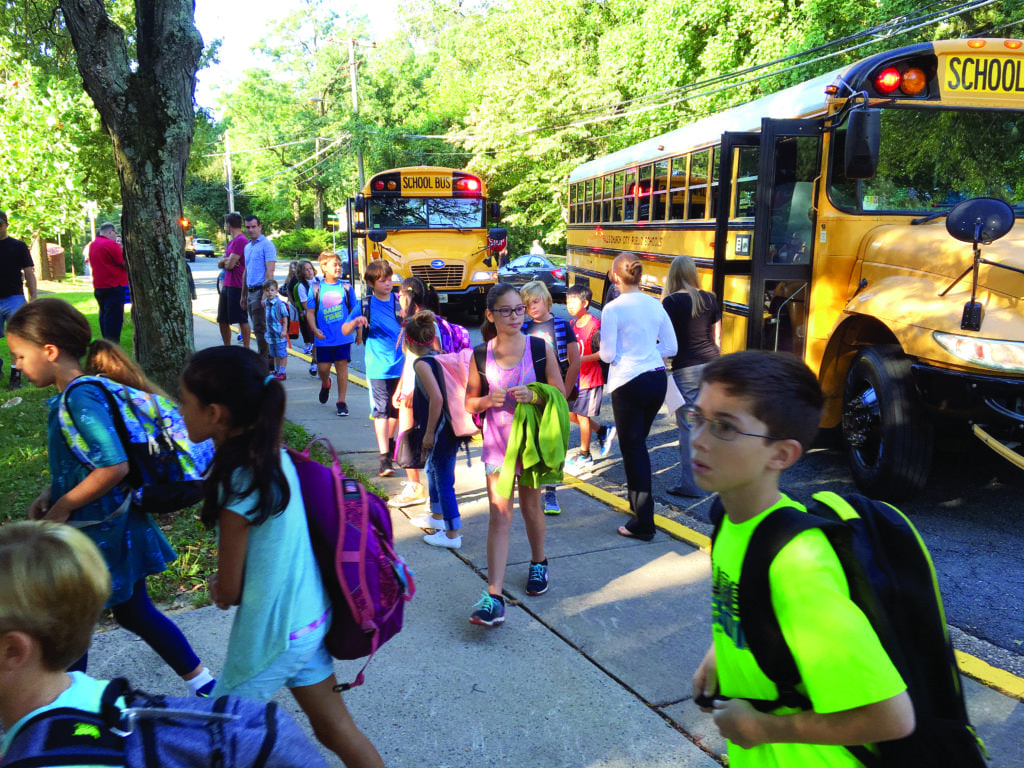 IT WAS BACK TO SCHOOL in the City of Falls Church this week with children all around town making their way to the classroom for another academic year. Here, buses drop off kids at Thomas Jefferson Elementary School before the first day of school on Tuesday morning. (Photo: Falls Church City Public Schools)