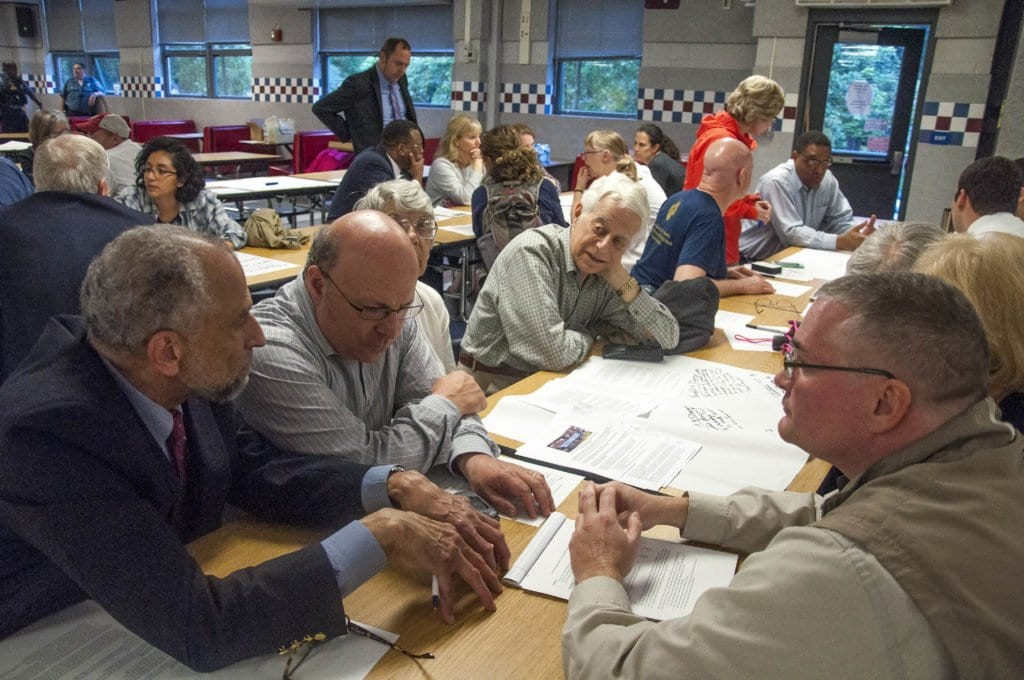 Members of the community surrounding J.E.B. Stuart High School talk about the pros and cons of changing the name of the school in one of the breakout sessions during the Fairfax County School Board's community meeting about the issue. (Photo: Drew Costley/News-Press)