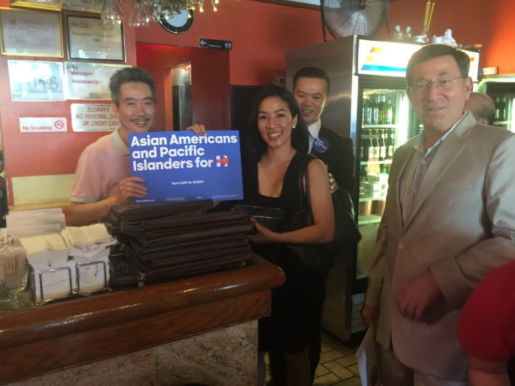 OLYMPIC FIGURE SKATER Michelle Kwan toured Falls Church's Eden Center today. She is shown here with the proprietor of the Huang Viet restaurant, with the center's manager Allen Frank on the far right. (Photo: News-Press)