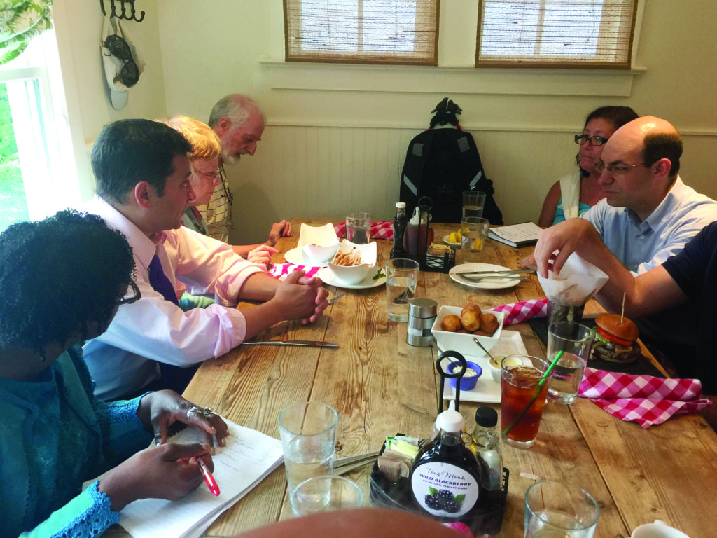 STATE DEL. MARK LEVINE (second from left) of Virginia held forth at a monthly open house for constituents at a restaurant in Del Rey last Saturday where the presidential election was on the forefront of everyone's mind. (Photo: News-Press)