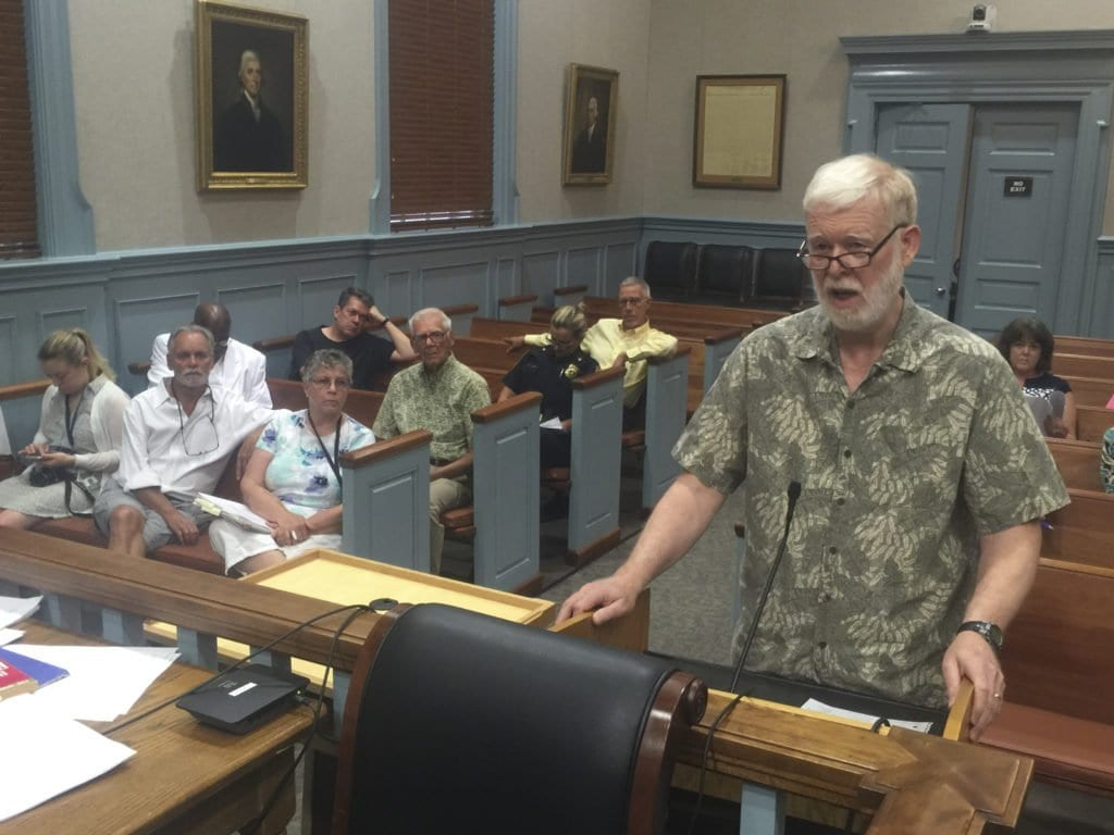JEFF PETERSON of the Mary Riley Styles Library Board of Trustees is shown addressing the F.C. City Council last night urging support for an action to order a bond referendum to expand and renovate the library. Shown seated behind him are other members of the library board. (Photo: News-Press)