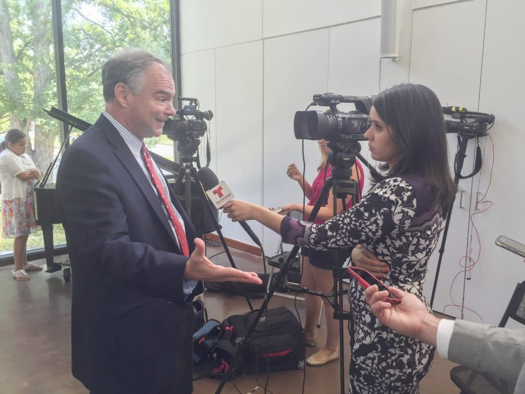 THOUGH SWAMPED by scores of media outlets in Arlington Thursday morning, U.S. Sen. Tim Kaine took time to answer questions in the Spanish language he is fluent in, as he did shown here. (Photo: News-Press)