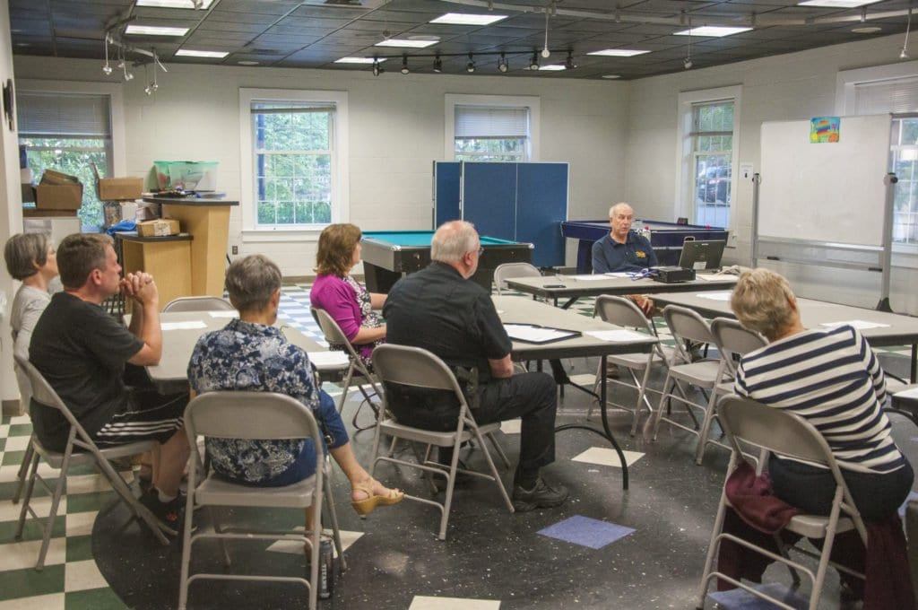 FALLS CHURCH RESIDENT GREG COX gives a presentation of his proposal for a center for day laborers in Falls Church on Tuesday, July 12 at the Falls Church Community Center. He aims to open a nonprofit center by June 2017. (Photo: News-Press)