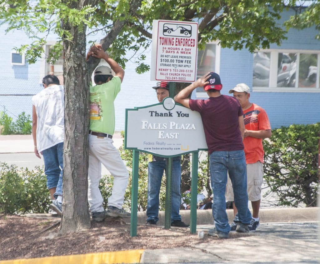 A GROUP OF DAY LABORERS gather near one of the entrances to the parking lot of the Falls Plaza East shopping center. Falls Church resident Greg Cox said that as many 14 or 15 day laborers gather there looking for temporary work. (Photo: News-Press)