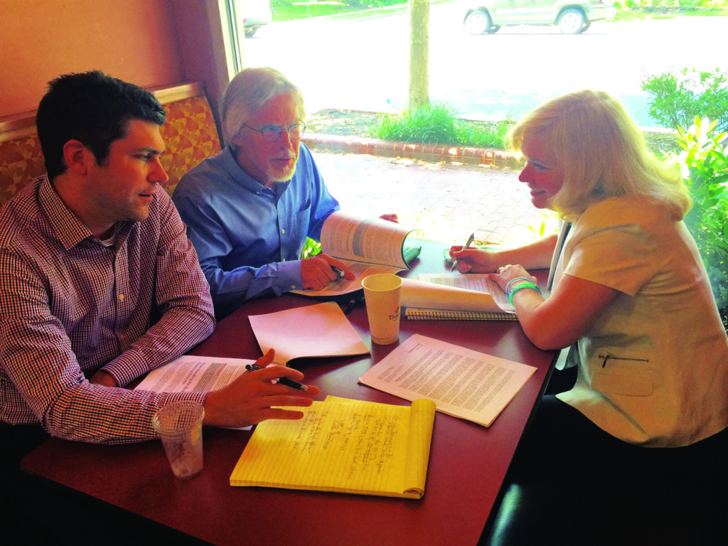 "KEY PLAYERS FOR THE Falls Church Chamber of Commerce's groundbreaking ""Resource Guide for Displaced Businesses"" are shown discussing their project at the local Panera Bread. Left to right, Andrew Painter, who initiated the project, Chamber board chair Joe Wetzel and Chamber executive director Sally Cole. (Photo: News-Press)"