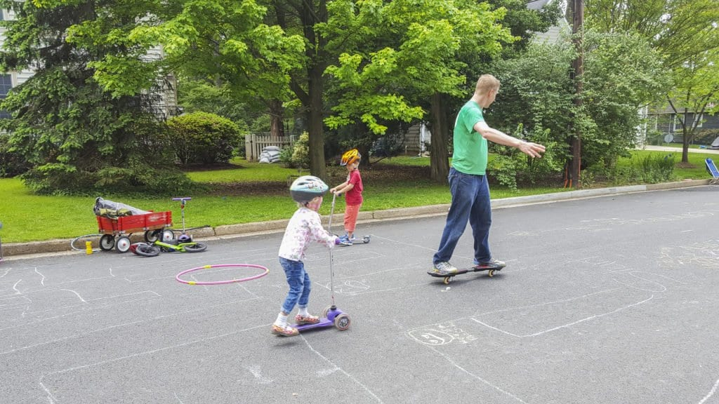 "FALLS CHURCH RESIDENTS ENJOY the first of the City's Play Streets Pilot Programs on Saturday, May 14 on N. Virginia Avenue and Riley Street. The City officialy sanctioned the program as an opportunity for residents to get outside, making streets playgrounds. Stephanie Rogers, the program's coordinator, said that ""streets are for everybody, not just cars. (Photo: Courtesy of Stephanie Rogers)"