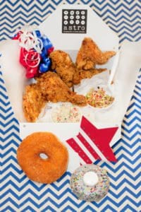 ASTRO DOUGHNUTS & FRIED CHICKEN is offering special Independence Day picnic baskets for four, filled with doughnuts, fried chicken, tater tots and cole slaw. (Photo: Courtesy Yensa werth)