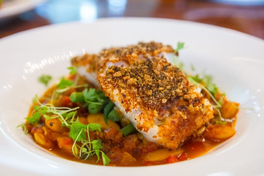 GREENHOUSE BISTRO'S COD has all the flavors of a seafood paella thanks to dehydrated onion, garlic, tomato, fennel pollen and dried bonito flakes. (Photo: Jody Fellows)