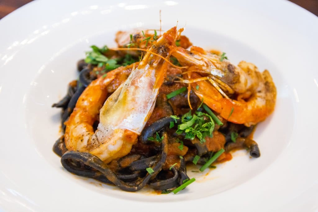 Greenhouse's black velvet bucatini is made with squid ink pasta and jumbo, head-on shrimp. (Photo: Jody Fellows)
