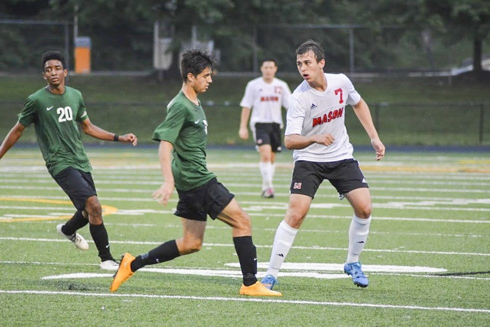 MASON SENIOR FORWARD ELLIOT MERCADO led the Mustangs in scoring in the team's state championship win against Bruton High School with a hat trick. (Photo: Carol Sly)