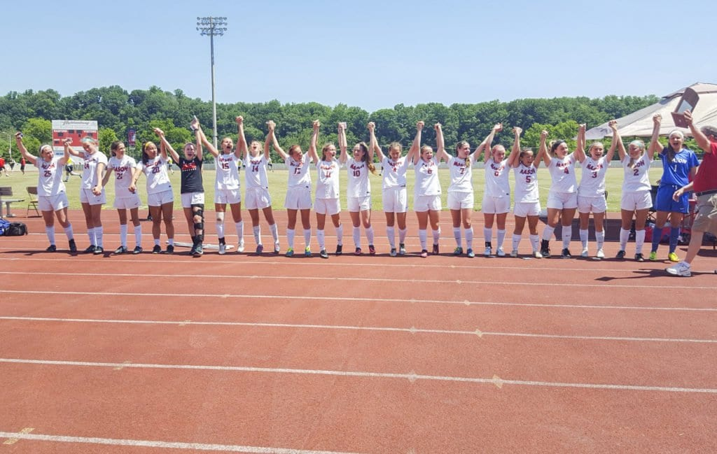 The George Mason High School varsity girls soccer team stands together at Radford University after winning their ninth straight state title. (Photo: Courtesy of Allison Clink)