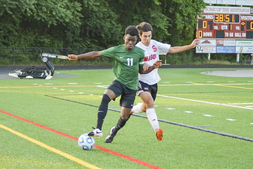 Junior midfielder Olo Sembera takes on a Bruton player during the Mustangs 3-0 victory over the team. Sembera set up the Mustangs' first goal of the game with a corner kick to senior forward Elliot Mercado. (Photo: Carol Sly)