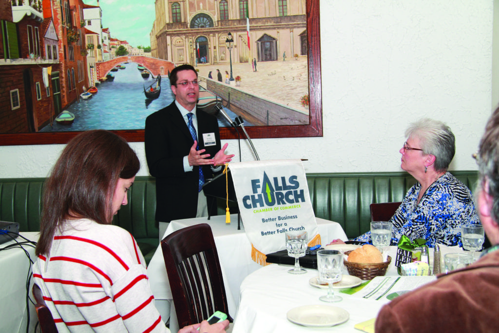 DAN GOLDFARB, a veteran planner with the Northern Virginia Transportation Commission, spoke about plans for introducing tolls on I-66 inside the beltway next year to the monthly luncheon of the Falls Church Chamber of Commerce last week. (Courtesy Photo: Brenda Schrier Photography)