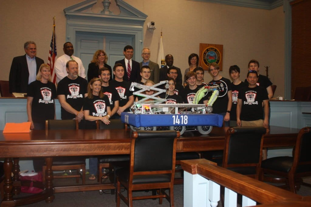 MEMBERS OF THE George Mason High School Robotics team that advanced to the world championships in St. Louis earlier this month were invited to pose with members of the Falls Church School Board Tuesday night. (Photo: News-Press)
