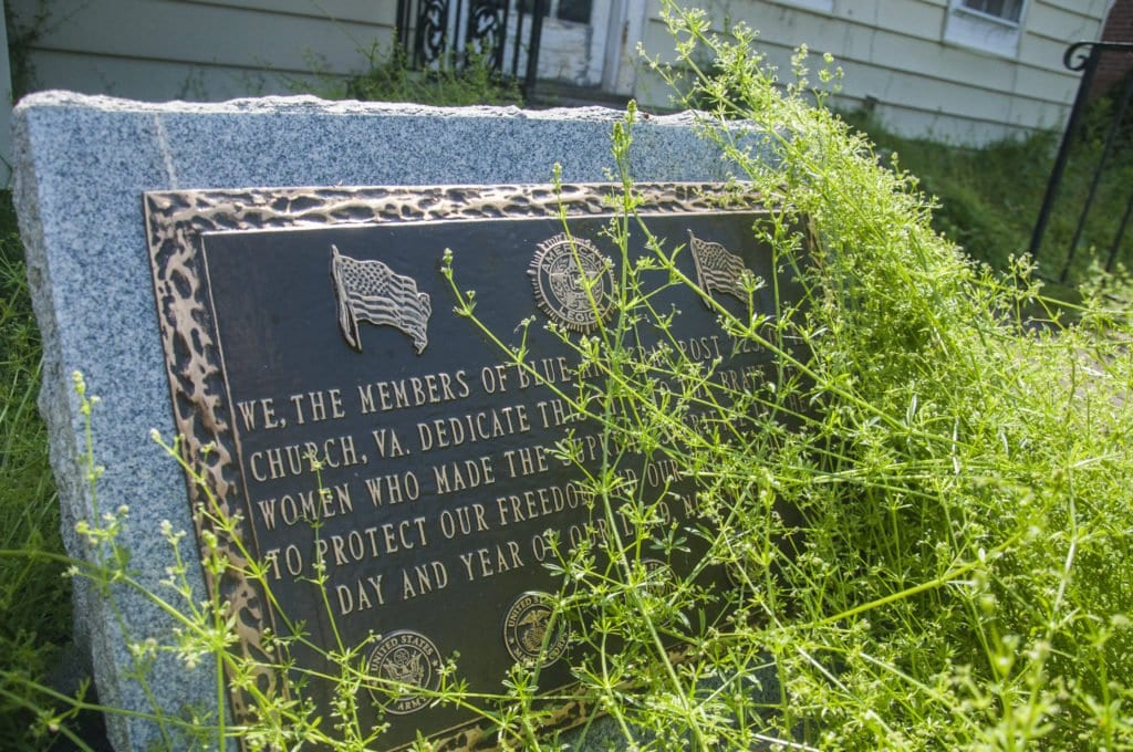 A DEDICATION STONE INSTALLED BY MEMBERS of what was then American Legion Post 225 sits in front of the building and is now nearly covered in weeds. The owners of the coming Northside Social restaurant said that the stone, dedicated to fallen American soldiers on November 11, 1997, will remain on the property, but will be moved so that it's closer to Park Avenue. (Photo: News-Press)