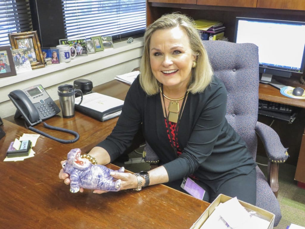 MOUNT DANIEL SCHOOL'S Kathleen Halayko sits in her office with a plush of the school's mascot, Danny the Hippo, in the photo above. Halayko was chosen by Falls Church City's Recreation and Parks board as the Grand Marshal of this year's Memorial Day Parade. (Photo: Patricia Leslie/News-Press)