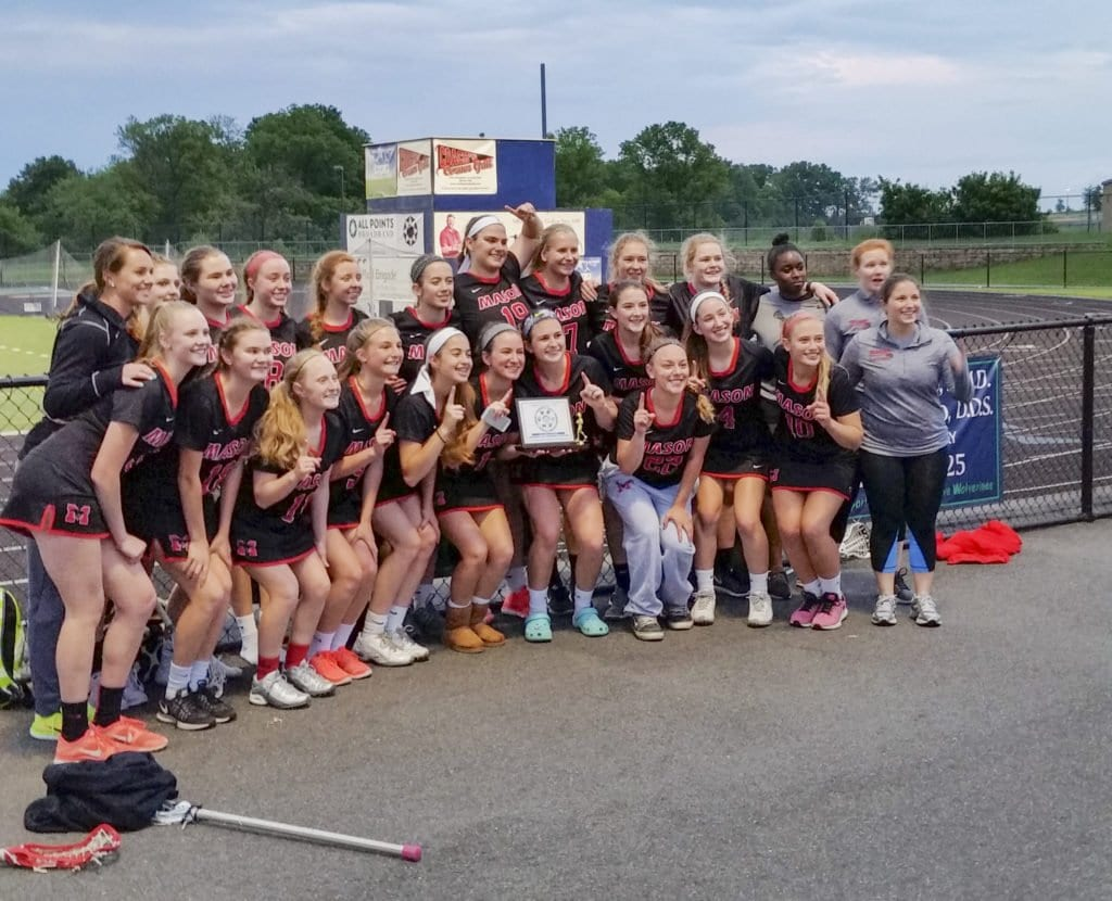 MASON'S LACROSSE TEAM celebrates their Dulles Conference Championship on Monday, May 23 after defeating Woodgrove High School, who were the defending state champs. (Photo: Courtesy of Jeffrey Wojtala)