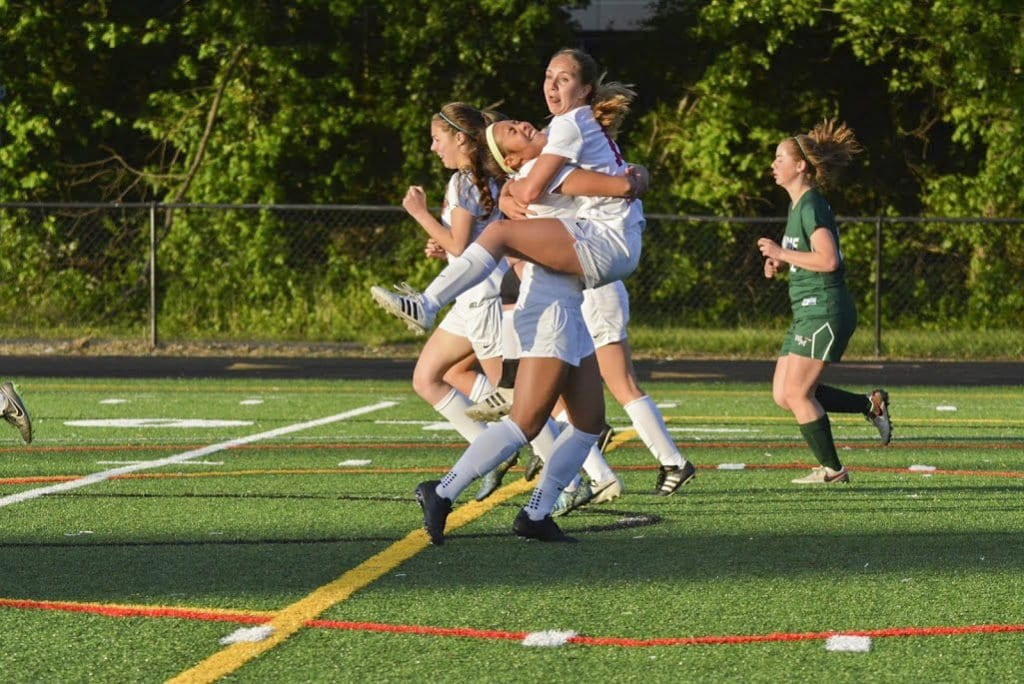 Mason senior Corrine Carson (right) jumps into the arms of Mason junior Rebecca Crouch (left) after her goal against William Monroe High School, which the Mustangs won 4-1. Crouch also scored a goal in the match. (Photo: Carol Sly)