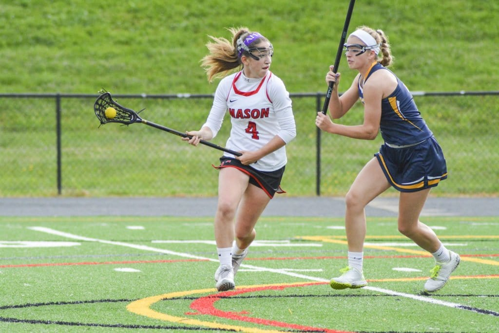 Mason's Amy Roche scored seven goals in the Mustangs' win over Loudoun County High School. (Photo: Carol Sly)