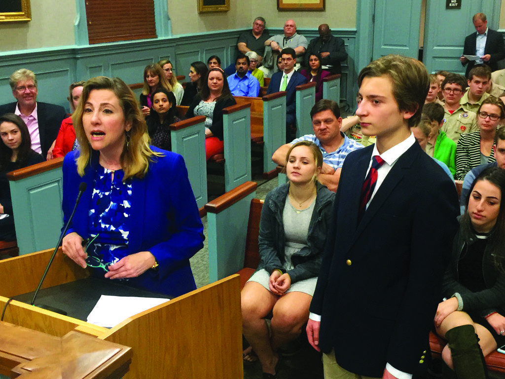 CAROL LOFTUR-THUN (left), who devised and developed the Youth Representative Initiative of the F.C. Citizens for a Better City, announced the 23 new students at Monday's meeting of the Falls Church City Council. She is joined at the podium by student Christian Autor, appointed last year to the Tree Commission. (Photo: News-Press)