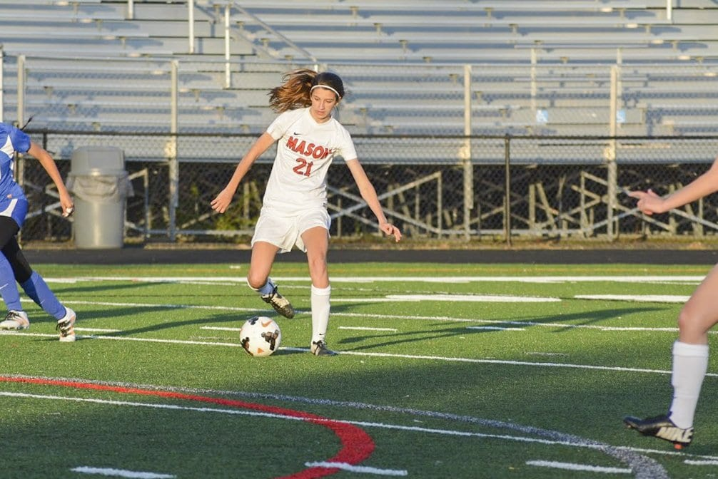 MASON SOPHOMORE IZZY ARMSTRONG dribbles the ball during a recent Mustang win. She scored a hat trick against Madison County High School. (Photo: Carol Sly)