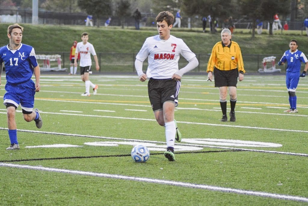 MASON SENIOR ELLIOT MERCADO dribbles the ball down the field during a recent Mustangs' win over Madison County High School. Mercado scored a hat trick against the Mustangs' most recent opponent, Strasburg High School, during the team's 5-0 win over the Rams on Friday, April 29. (Photo: Carol Sly)