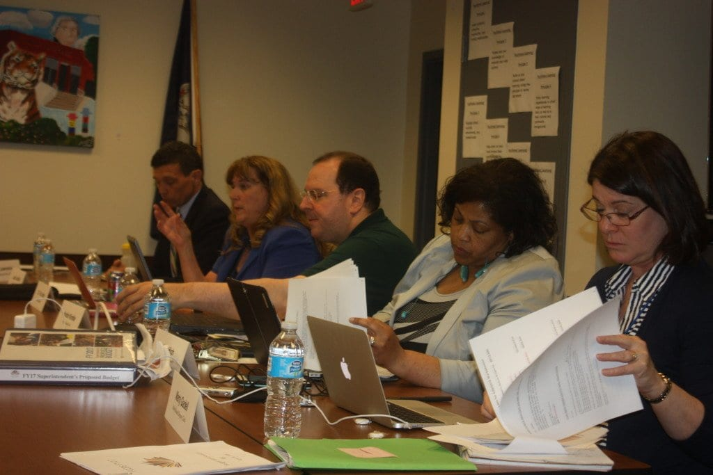 WRESTLING WITH THE CONSEQUENCES of a $912,000 cut in their budget at Tuesday's School Board meeting were (l. to r.) Vice Chair John Lawrence, Chair Justin Castillo, Superintendent Dr. Toni Jones, Financial Czar Humble Kimble, Assistant Superintendents Lisa High and Marty Gadell. (Photo: News-Press)