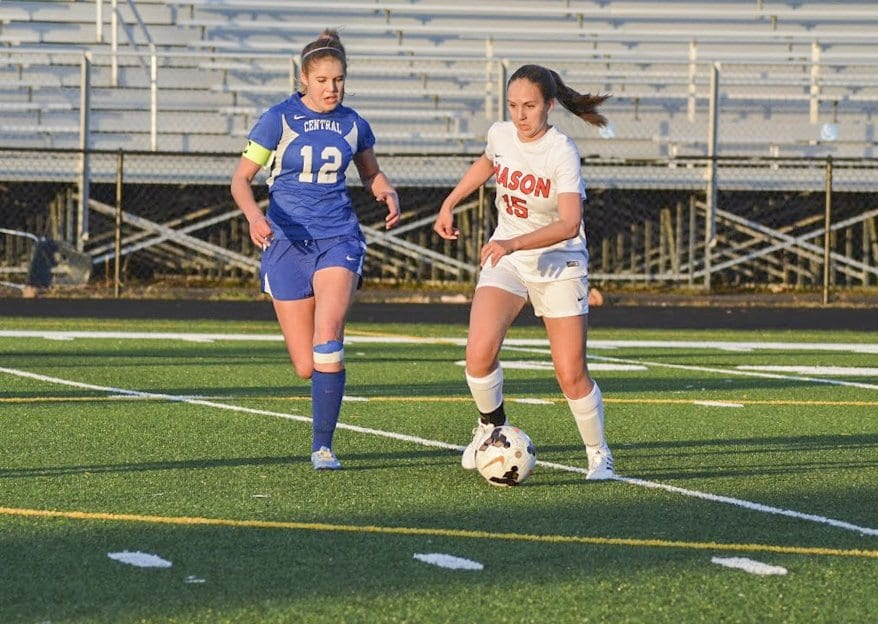 MASON SENIOR CORINNE CARSON attempts to dribble past a Central High School defender in a recent win by the Mustangs. She was part of a steady midfield that sparred against William Monroe High School in a 1-0 win. (Photo: Carol Sly)