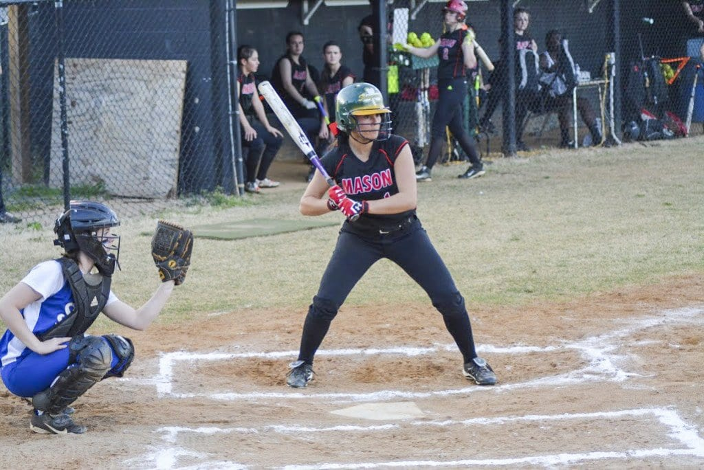 MASON SOFTBALL'S LEADOFF HITTER JULES CARTER looks for a signal from first during the Mustangs' 12-2 defeat of Seton School on Monday, April 18. Carter had a single and scored three runs against Seton. She scored three runs in the Mustangs' 12-0 defeat of Rappahannock County High School on Friday, April 15. (Photo: Carol Sly)