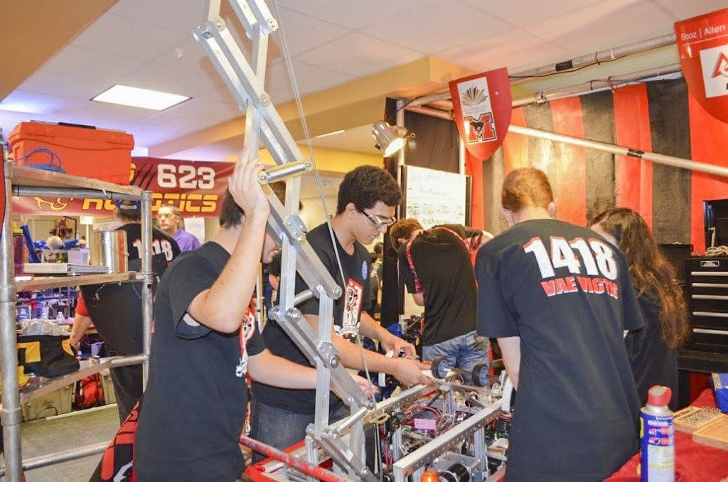 Team 1418's pit crew works on a robot in between games during a recent compeition. The team is headed to Worlds, which takes place April 27-30. (Photo: Carol Sly)