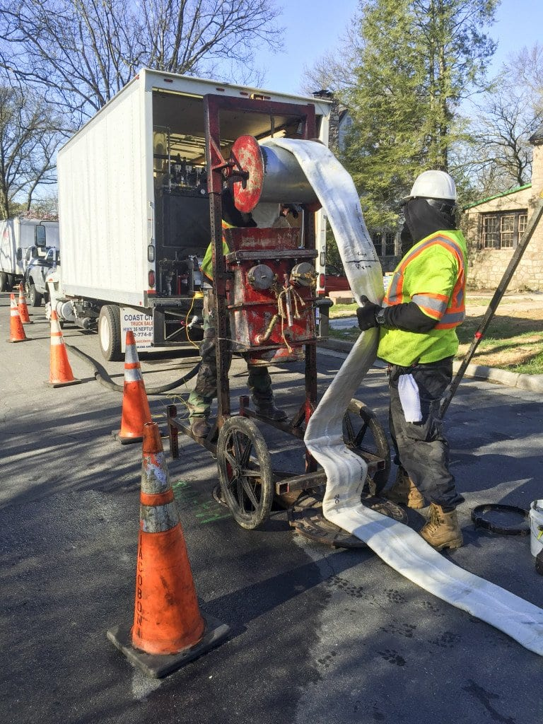 A CITY EMPLOYEE UNLOADS fiberglass lining to rehabilitate the sanitary sewer system on Linden Lane on Wednesday, March 30. (Photo: Courtesy of Lonnie Marquetti)