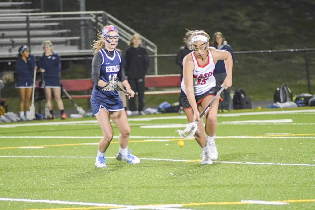 Mason sophomore Claire Hiscott scoops up a ground ball during the Mustangs' 21-3 trampling of Washington-Lee High School on Monday, March 28. Hiscott scored a hat trick against the generals and had the assist on another goal. (Photo: Carol Sly)