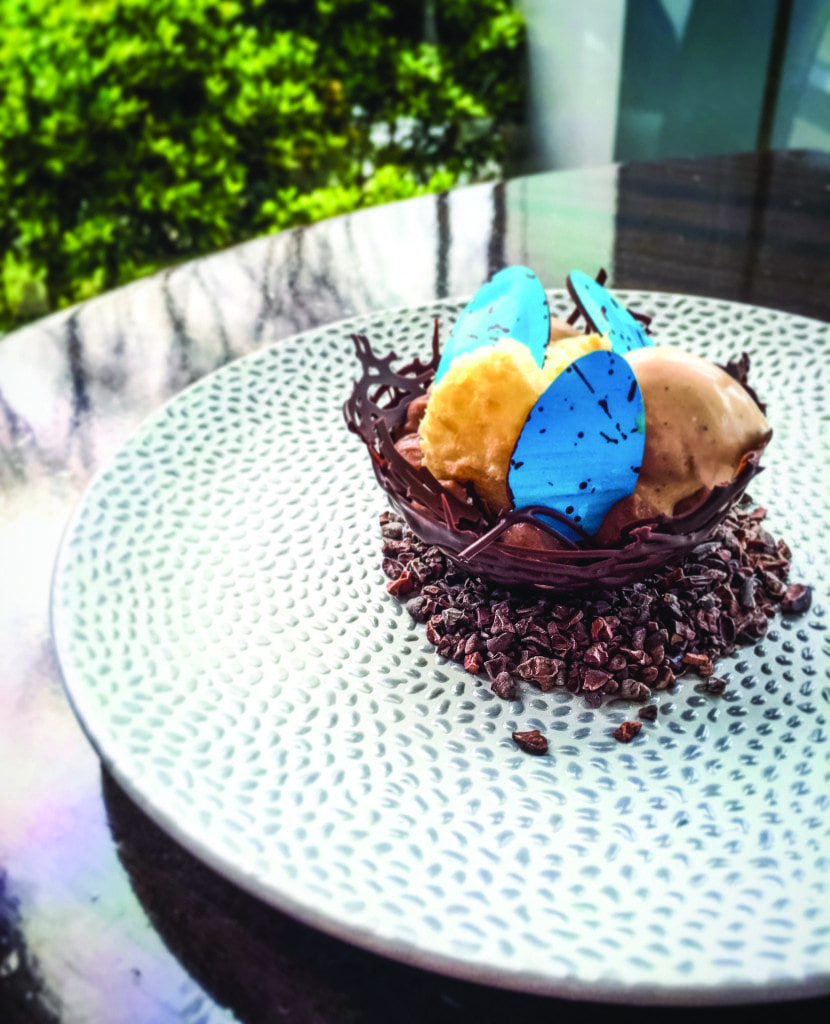 """2941 RESTAURANT'S Caitlin Dysart is once again serving up her """"Chocolate Easter Basket"""" this Sunday, filled chocolate fudge cake, coconut macaroon, toasted almond gelato and chocolate eggs. (Photo: 2941 Restaurant)"""