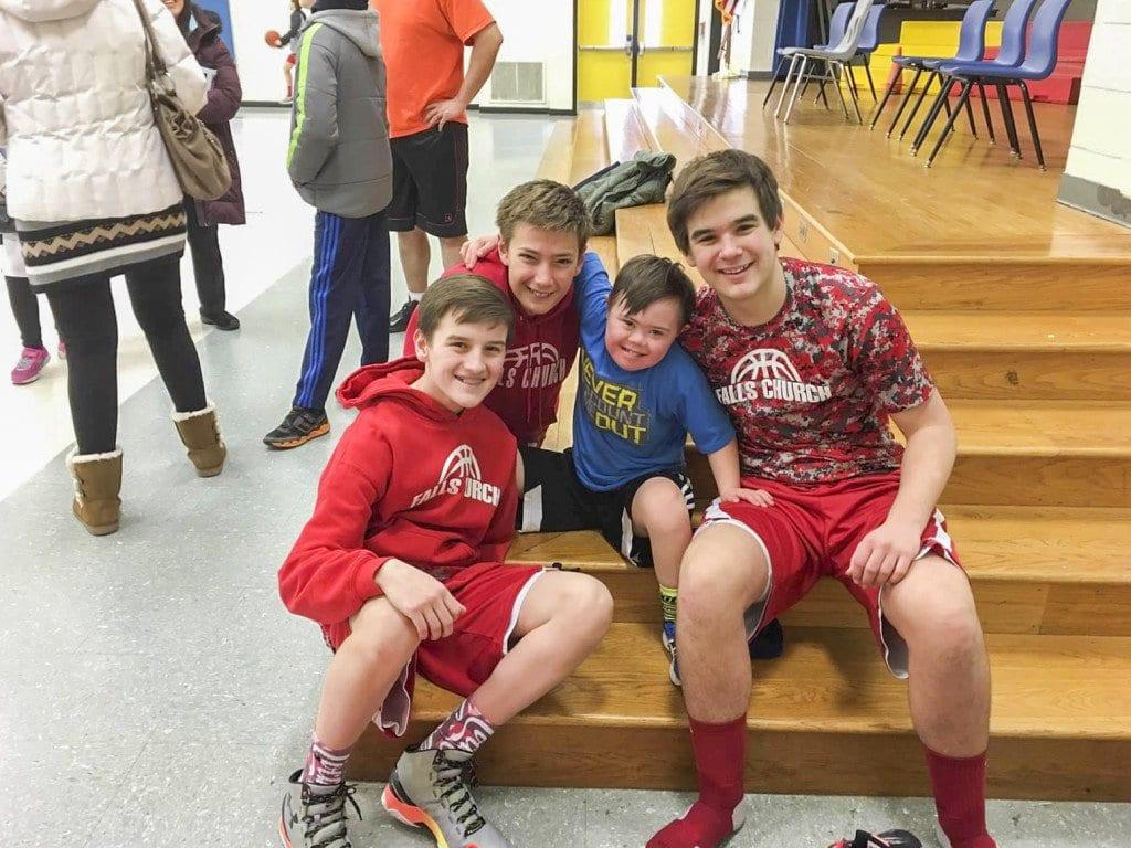 Marty Casserly, Owen Thomas and Marco Ferrara, members of the Falls Church City 7th grade select basketball team, pose for a picture with Tyler during the team's volunteer effort with the Special Olympics of Loudon County. (Photo: Courtesy of Jennifer Thomas)