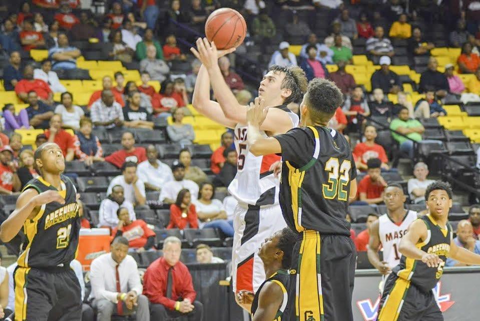 MASON SENIOR ELLIOT MERCADO hoists a shot against Greensville County High School during the Virginia High School League's 2A state semifinal. (Photo: Carol Sly)
