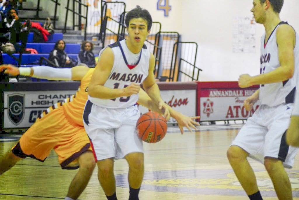 MASON SENIOR ELIOTT MERCADO sank the two free throws that sent the Mustangs into overtime against Greensville County. He's shown here driving down the court against Graham High School in the opening round of the state championship. (Photo: Carol Sly)