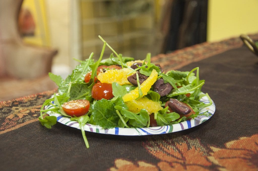 The salad in the image above is made up of leafy greens, tomatoes, kalamata olives and oranges. The salad's dressing is made of citrus juice and olive oil. (Photo: Drew Costley/News-Press)