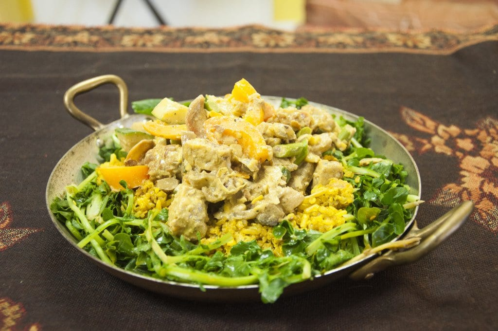 The Curried Tempeh and the Veggie Pizza from Chef Bon's Yum Truck are two of the food truck's newest dishes. The Curried Tempeh is served over a bed of watercress and fried rice, which is made up of brown basmati rice, quinoa and seeds. (Photo: Drew Costley/News-Press)