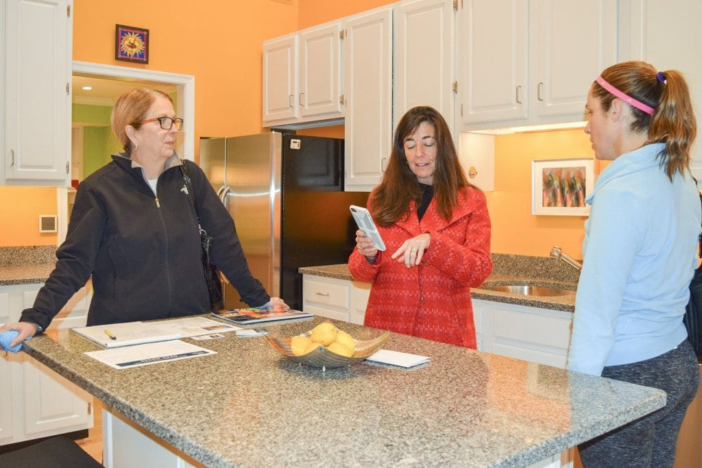 Hennessey (center) speaks with potential buyers during an open house in Falls Church..  (Photo: Liz Lizama/News-Press)