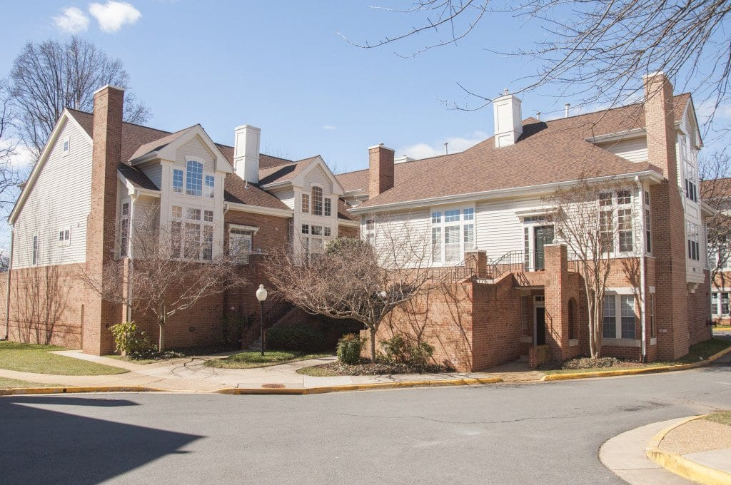 THIS TOWNHOUSE COMMUNITY is located on Haycock Road across the street from George Mason High School, the fifth highest ranked public high school in Virginia, and has two units that are listed for under $600,000. (Photo: Drew Costley/News-Press)