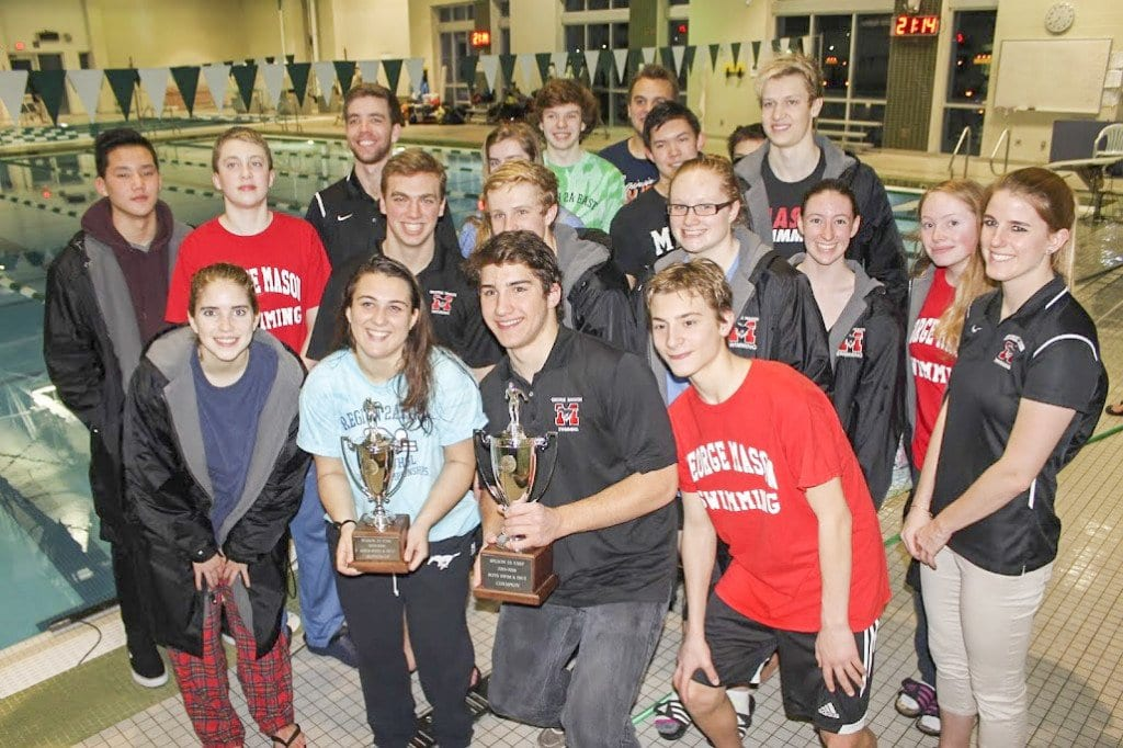 MASON'S SWIM AND DIVE TEAM poses with their Region 2A championship trophies after the regional meet on Saturday, Feb. 13. (Photo: Carol Sly)