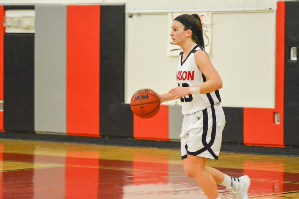 MASON JUNIOR SARAH LUBNOW brings the ball up for the Mustangs during their 42-23 defeat of Clarke County High School. (Photo: Carol Sly)