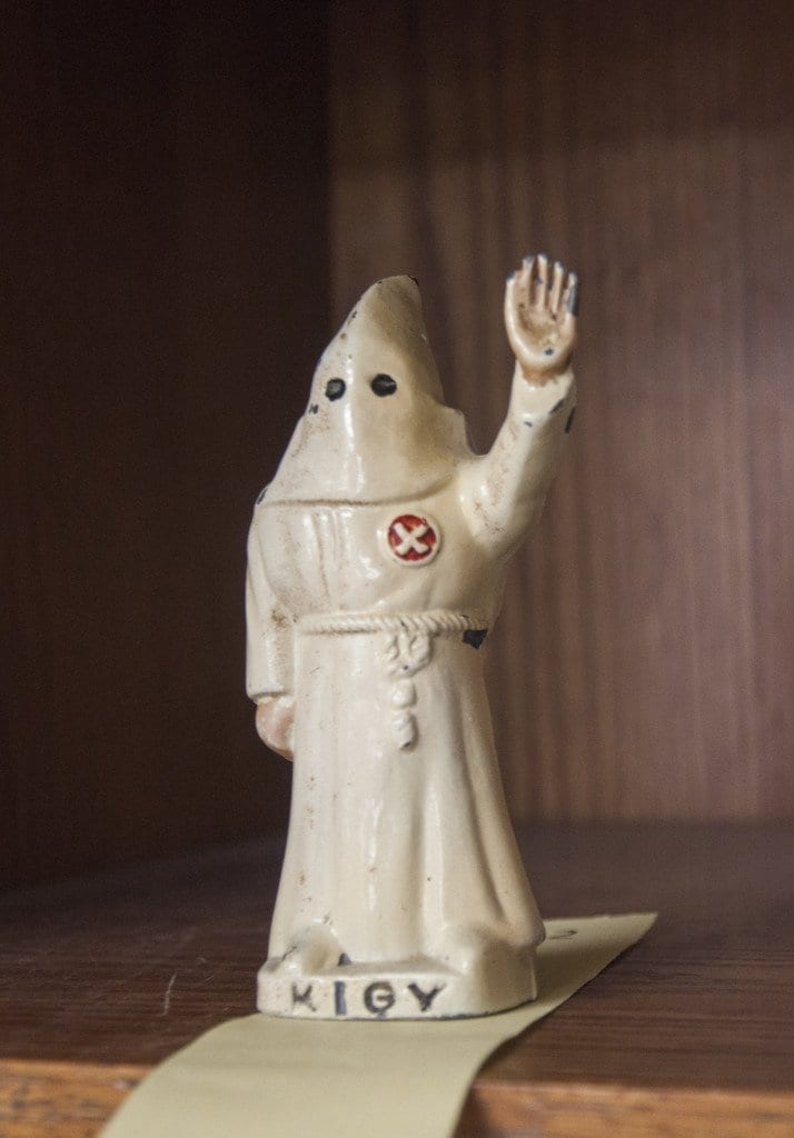 """A cast iron figure of a Ku Klux Klansman, inscribed with the initials K.I.G.Y., which stands for """"Klansman I Greet You,"""" is one of three lots for sale in the Quinn's auction that feature Ku Klux Klan memorabilia. (Photo: Drew Costley/News-Press)"""