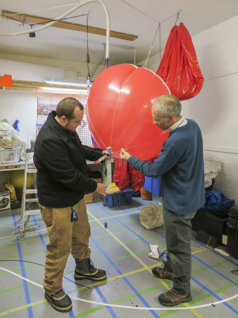 Digital Design & Imaging Service in Falls Church uses cameras attached to balloons like the one in the image above to capture aerial photos. Ryan Shuler, project manager and lead photographer at Digital Design & Imaging Service, Inc., on left, and company founder and president Curt Westergard, hunt for leaks in a balloon. (Photo: Patricia Leslie/News-Press)