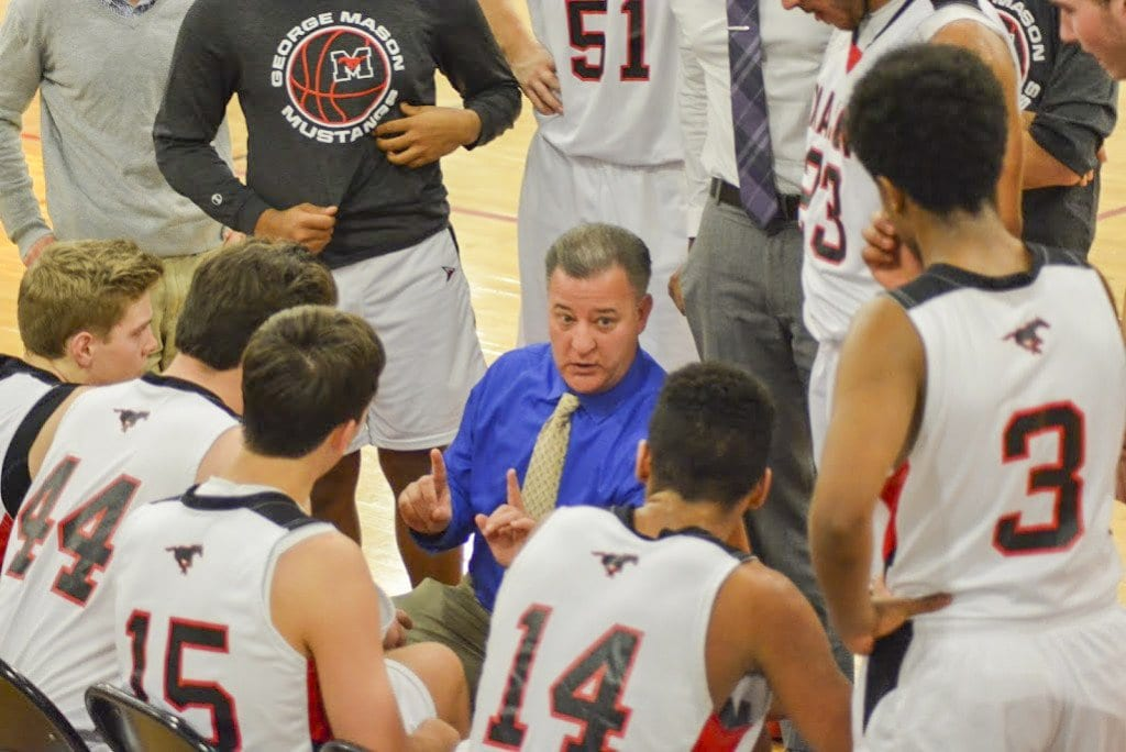 MASON COACH CHRIS CAPANNOLA TALKS to the Mustangs during a timeout. (Photo: Carol Sly)