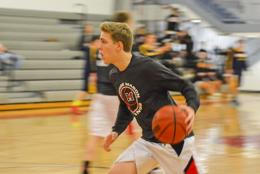 Mason senior guard Josh Allen drives toward the hoop during the Mustangs' warm up before their defeat of Rappahannock County High School. (Photo: Carol Sly)