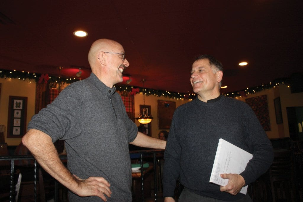 REV. JOHN OHMER (RIGHT), rector of the historic Falls Church Episcopal, and Christopher Fay, executive director of the F.C.-based homeless services non-profit, Homestretch, compared notes about working together on bringing a Syrian refugee family into Falls Church. (Photo: News-Press)